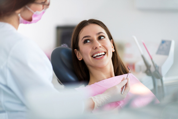Woman smiling in a dental chair at Calapooia Family Dental in Albany, OR